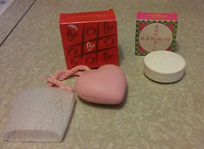 Avon, far away scent full of love soap on rope and aspirin soap.