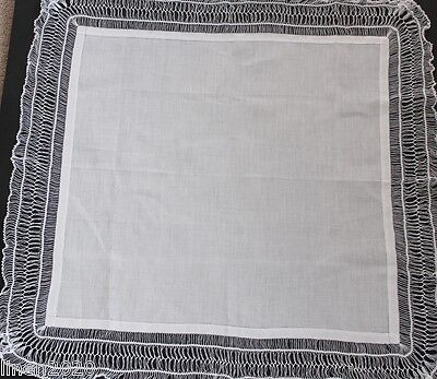 Vintage white linen table top cloth with hand worked hairpin lace edge.