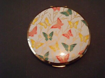Beautiful multi coloured butterfly vintage powder compact by Kigu