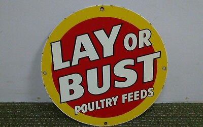 Old vintage LAY OR BUST POULTRY FEEDS sign porcelain metal farm seed feed