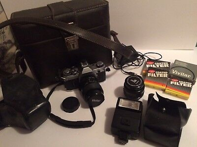 VTG. CANON AE-1  35mm SLR Camera  - 2 Lenses -Speedlite -Filters -Case -Manuals