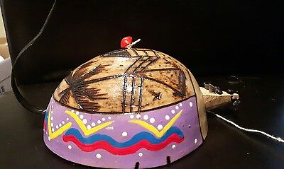 Handmade wooden coconut toy carved mouse on a string caribbean souvenir