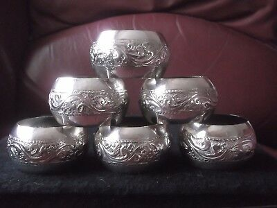 Six Decorated White Metal Napkin Rings - 85g