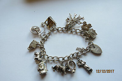 Vintage solid silver charm bracelet great gift 44g, nicely balanced:lovely wear