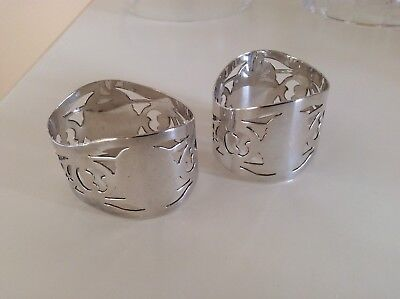 2 Silver Plated Napkin Rings .