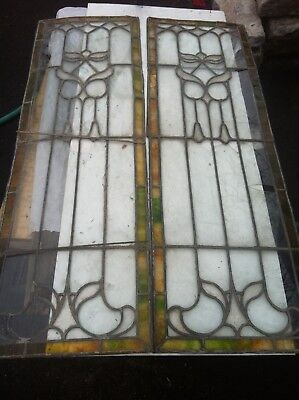 Pair of matching stained glass windows.