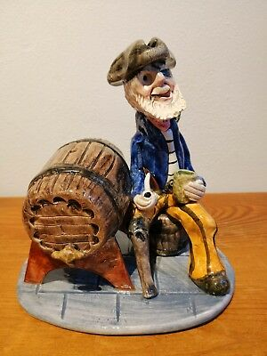 Alan Young Pottery - Sitting Peg leg with green parot sampling the rum!!