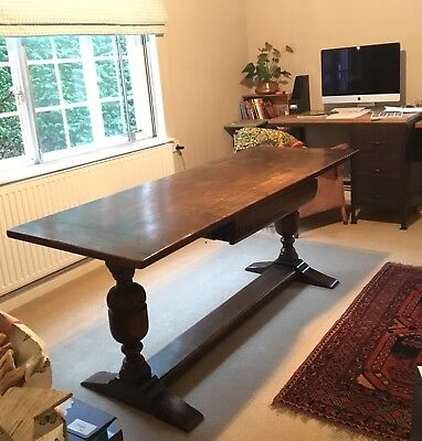 Oak Refectory dining table with removable top and drawer.