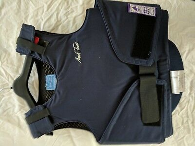 Mark Todd child's horse-riding body protector complete with zipped cover.