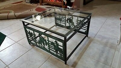 Western style glass top, cast iron coffee table