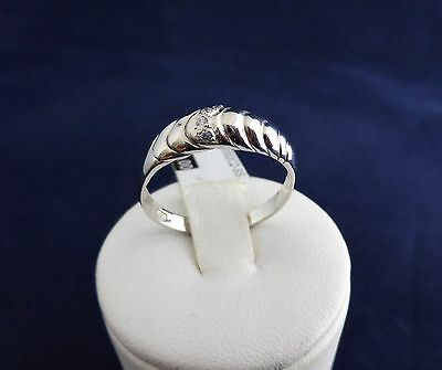 SOLID STERLING SILVER DRESS RING 4x1.0mm cubic zirconias 1.7gr.