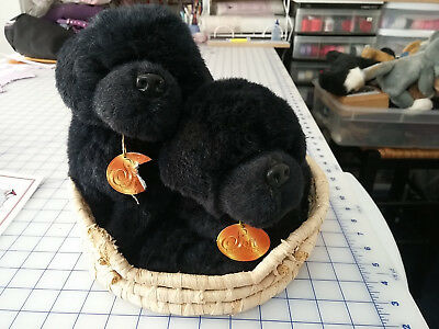 Two adorable Plush Newfoundland puppies in a basket