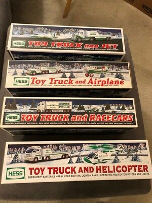 2002, 2003, 2006 and 2010 Hess Trucks - Bundle - New in Box - with shopping bag