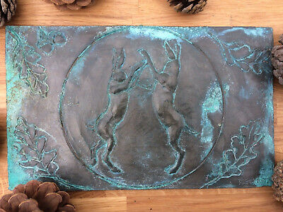 Boxing hares in the moonlight antique metal effect wall plaque, hare wall art