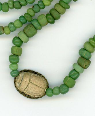 Ancient Egyptian Scarab Bead on string of green Indo-Pacific Glass Trade Beads