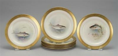 EIGHT LENOX HAND-PAINTED PORCELAIN FISH PLATES With gold rims. Signed... Lot 276
