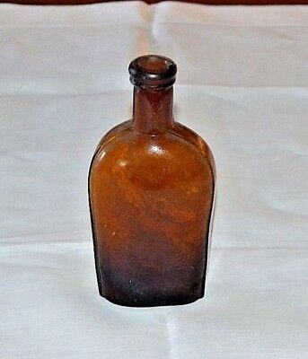 Flask Side Strap Circa early1900's Amber / brown  Glass  medicine whiskey