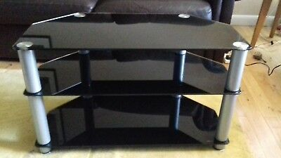 Black 3 Tier Tempered Glass TV Table. Faint scratch on top, barely visible.