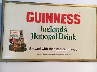 Vintage Guinness Beer Sign with raised lettering and picture of Leprechaun