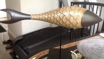 DECORATIVE GOLD AND BLACK METAL FISH ON A PEDESTAL 14x23