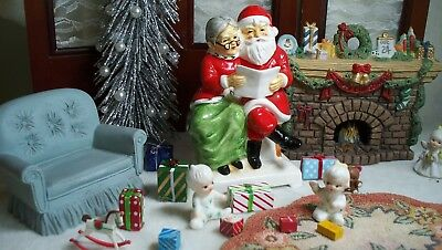 Vintage SANTA and MRS CLAUS sitting together reading A ICONIC PIECE Come see it!