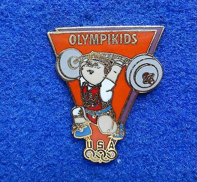 NEW ~ Orange Cabbage Patch Doll Olympikids Mascot USA Olympic Weightlifting Pin