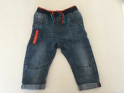 Baby boy jeans 6-9 months funky style with elasicated waiste and orange zip new