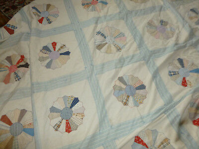 antique quilt done in the pinwheel pattern. nice coloring 78 x 88