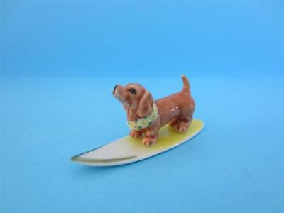 NEW DOG FIGURINE HAWAII DACHSHUND ON YELLOW SURFBOARD  FIGURINE *Mint*