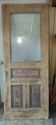 Old wood exterior door with wavy glass window, already stripped, patched, sanded