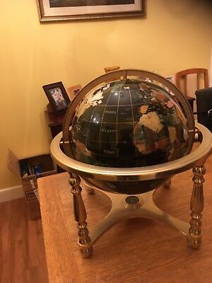 Semi Precious World Globe On Brass Coloured Stand black in colour which is best