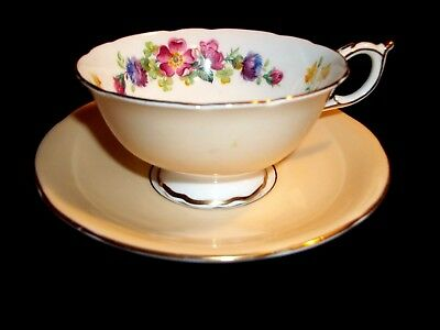 PARAGON CHINA Queen Elizabeth and Queen Mary Beige and Flowered Teacup & Saucer