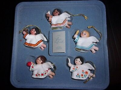 Set of five Peace on Earth Angel ornaments by Avon, 1983, various cultures