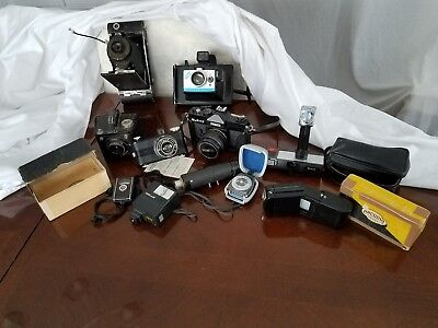 Mixed Lot of Vintage Cameras & Photography Accessories sold as is.
