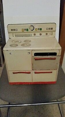 Vintage play metal stove, toaster and plates and pans