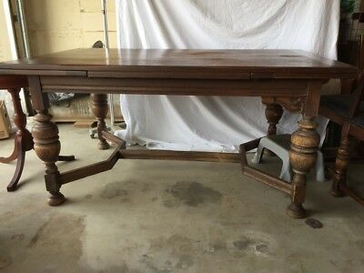 English Tudor Style 1920s Antique Carved Oak Dining Table and Six Chairs
