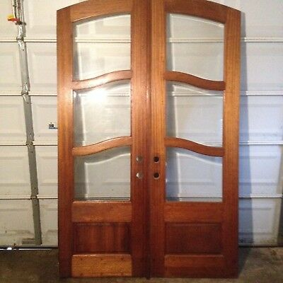 Beautiful Eyebrow Arch Top Double Entry Doors With Unique Beveled Glass Panes