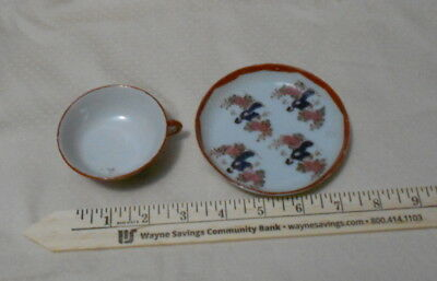 GEISHA GIRL TEACUP AND SAUCER OLD UNMAKRED embossed and painted in