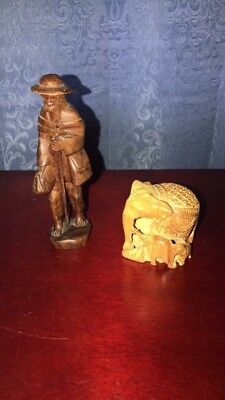 Two Vintage hand carved wooden figurines.
