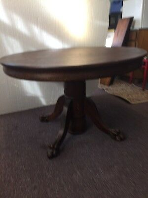 "1890's American quarter sawn oak 44"" claw foot Hastings dining table w/ 5 leaves"