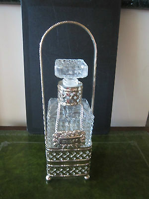 RETRO VINTAGE DIAMOND CUT DECANTER IN SILVER PLATE CARRIER.Made in England