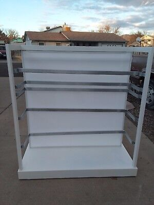 Retail Clothes Rack with movable brackets, 2 sided with plexiglass center.
