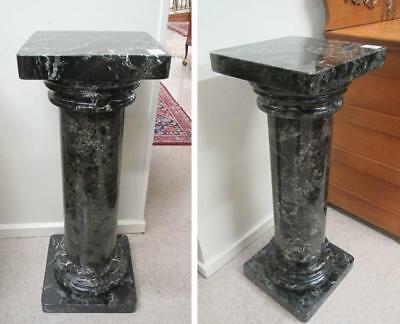A PAIR OF MARBLE PEDESTALS, matching Italian black Lot 482