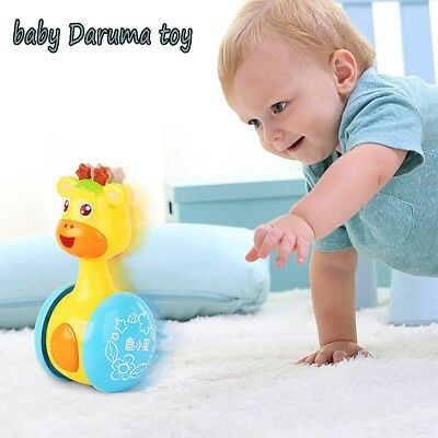 Educational Cartoon Roly-poly Baby Toys Giraffe Tumbler Doll Rattles Ring Bell