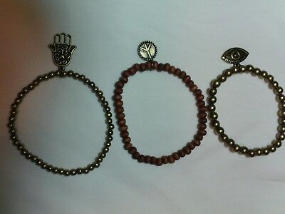 Bracelets. Set of Three. Two Bronze. one Brown. With Charms.