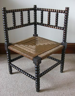 1930's Medium Oak Bobbin Turned Corner Stool with Seagrass top