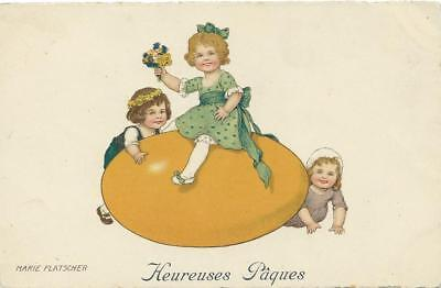 Marie Flatscher  Children with large yellow Easter Egg