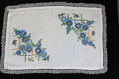Vintage white linen tray cloth with hand embroidered blue flowers.