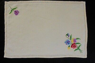 Vintage cream linen tray cloth with machine embroidered flowers.