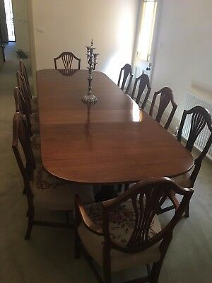 Extension dining table and 12 chairs in antique Duncan Phyfe style